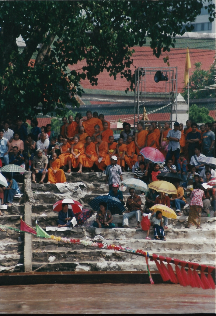 Orange-clad monks enjoy the show