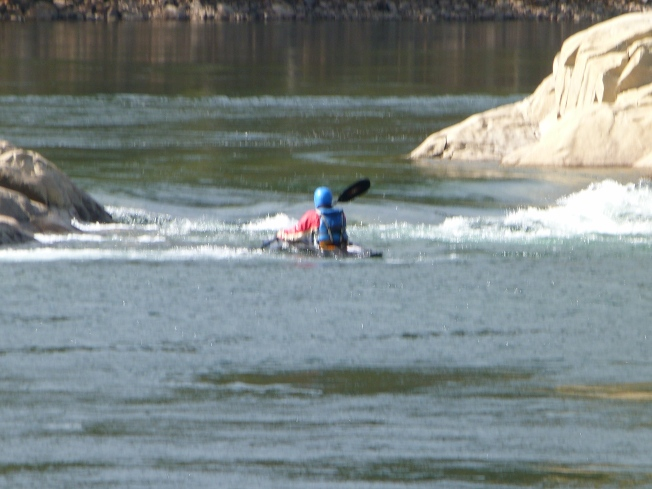 A Kayaker practicing white-watering