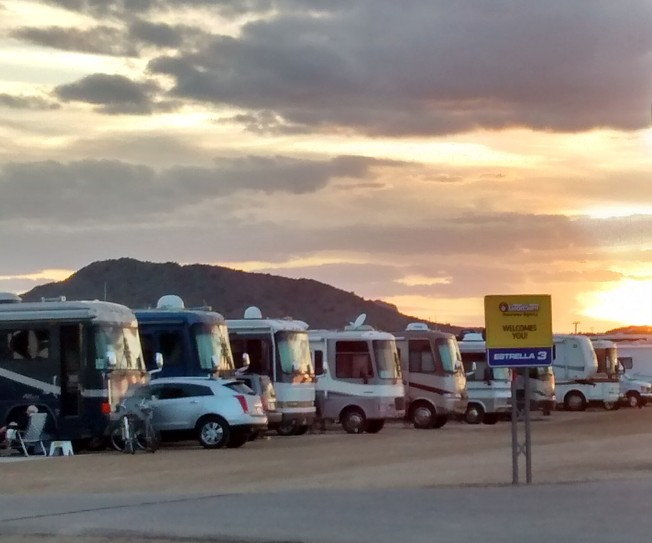 Rows of RVs under the sunset
