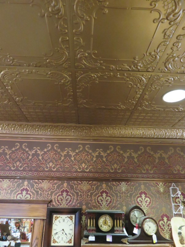 "New ""old"" tin ceilings and ornate wallpaper"