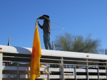Lasso Artist Performing on top of Horse Trailer