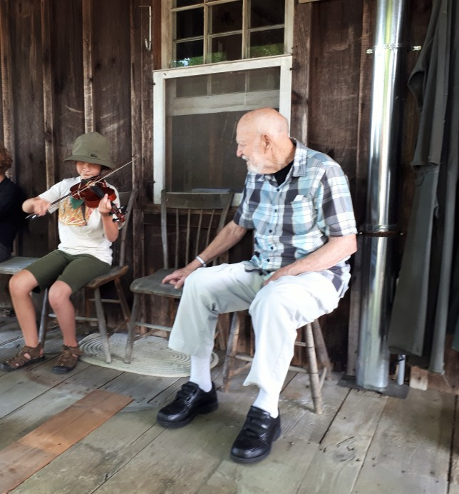 Granddaughter Entertaining her Great-Grandfather.